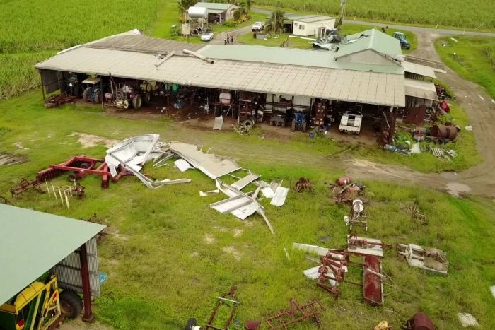 Aerial shot of sheds with debris across the farm.
