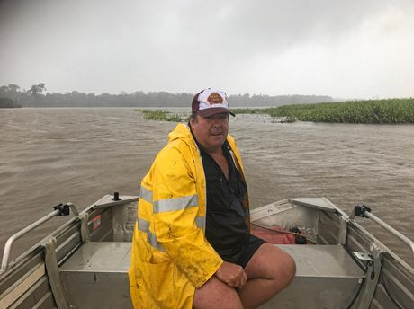 FARM FLOOD: Canegrowers Bundaberg chairman Allan Dingle at his cane farm on Moorlands Rd after last month's rain. Mr Dingle used a boat to check on his farm, where water was well above his crop.